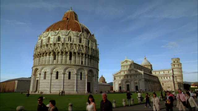 tourists walk along the piazza del duomo near pisa cathedral. - pisa cathedral stock videos & royalty-free footage