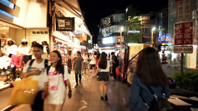 tourists walk and visit the crowded street in central of taipei. taiwan - taiwan stock videos & royalty-free footage