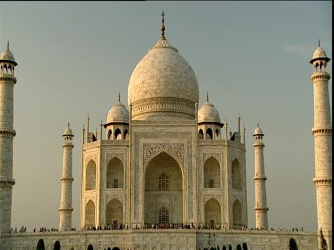 Tourists walk around entrance to Taj Mahal Agra