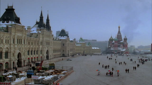 tourists walk around red square in moscow during the winter. - red square stock videos & royalty-free footage