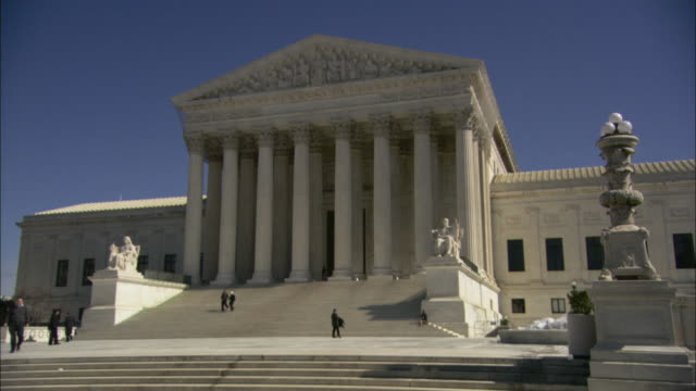 tourists walk around the us supreme court building. - u.s. supreme court stock videos & royalty-free footage