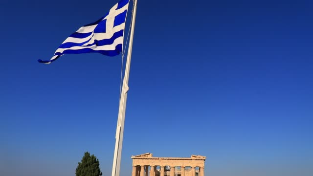 tourists walk as the greek flag waves at the parthenon temple at the acropolis on august 23 2020 in athens greece during the coronavirus pandemic... - greek flag stock videos & royalty-free footage