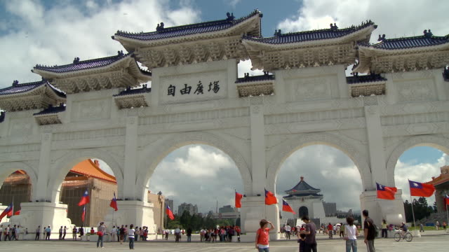 tourists walk by the gates of the chiang kai-shek memorial hall - chiang kaishek memorial hall stock videos & royalty-free footage