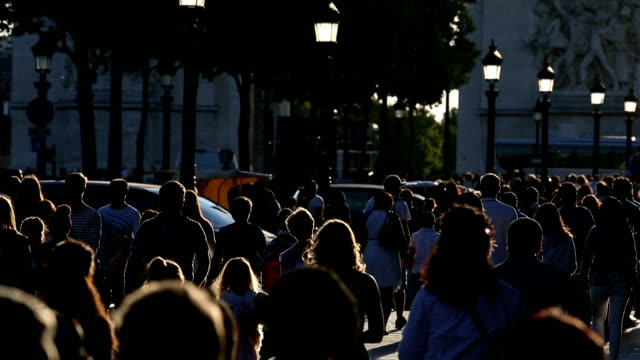 tourists walk down the champs elysees with late afternoon sun - france stock videos & royalty-free footage