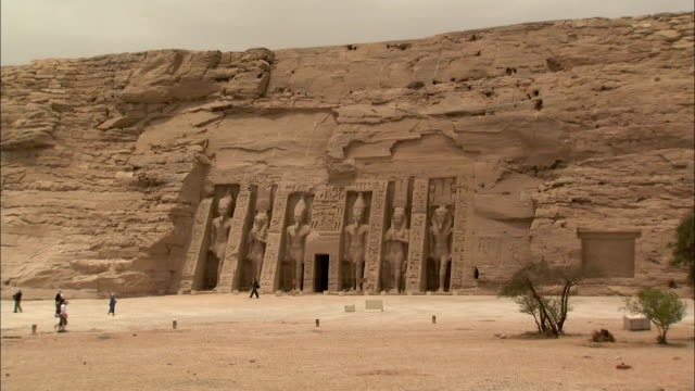 tourists walk in front of the great temple and the small tempel at abu simbel.\n available in hd. - latitude stock videos & royalty-free footage