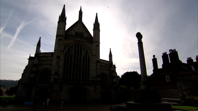 tourists walk in front of the historical cathedral in winchester. available in hd. - hampshire england stock videos and b-roll footage
