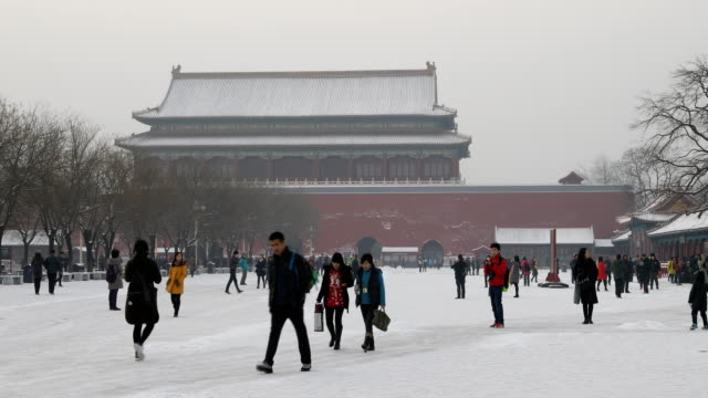 tourists walk in the snow at the forbidden city on february 22, 2017 in beijing, china. - beijing stock videos & royalty-free footage