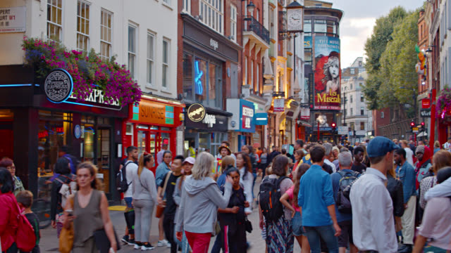 tourists walk on fashion street with stores and cafes. - walkable city stock videos & royalty-free footage