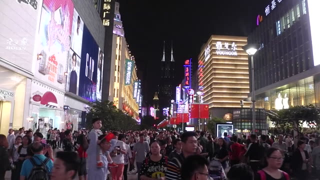 tourists walk on nanjing road in shanghai. - nanjing road stock videos & royalty-free footage