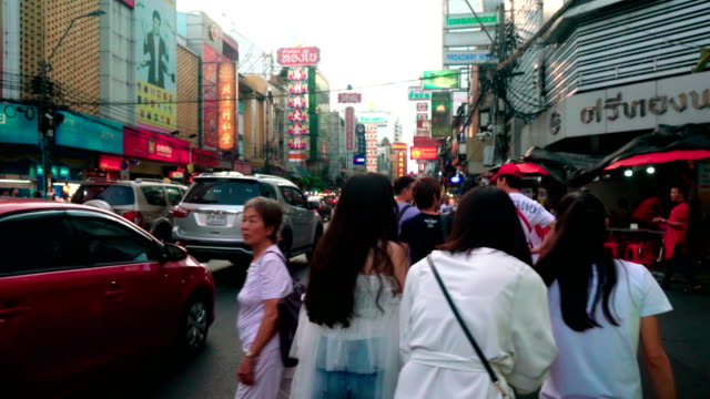 tourists walk on the shopping street of chinatown district, a popular tourist destination in thailand. - editorial stock videos & royalty-free footage