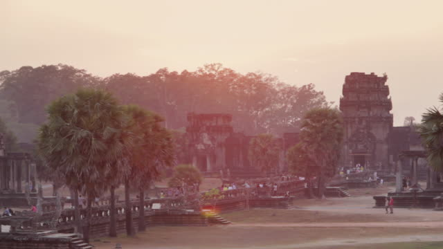 LS, PAN Tourists walk through Angkor Wat temple at sunset / Siem Reap, Cambodia