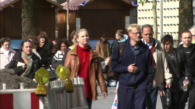 Tourists walk through Berlin.