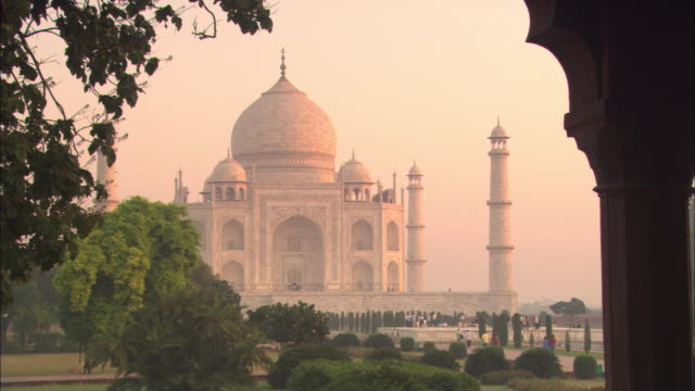 tourists walk toward the taj mahal. - taj mahal stock videos and b-roll footage