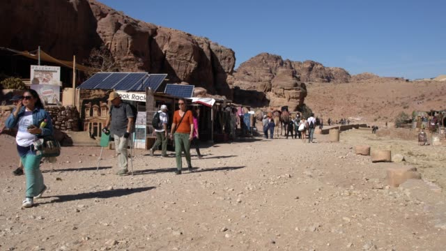 tourists walking alongside the souvenir shops in petra, jordan - 6th century bc stock videos and b-roll footage