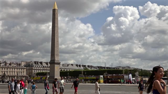 tourists walking and taking pictures at place de la concorde in paris france in the background the obelisk - obelisk of luxor stock videos & royalty-free footage
