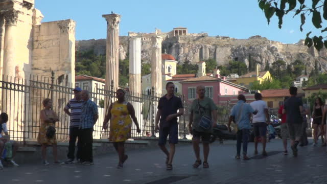 tourists walking around athens with parthenon and acropolis in the background - acropolis athens stock videos & royalty-free footage