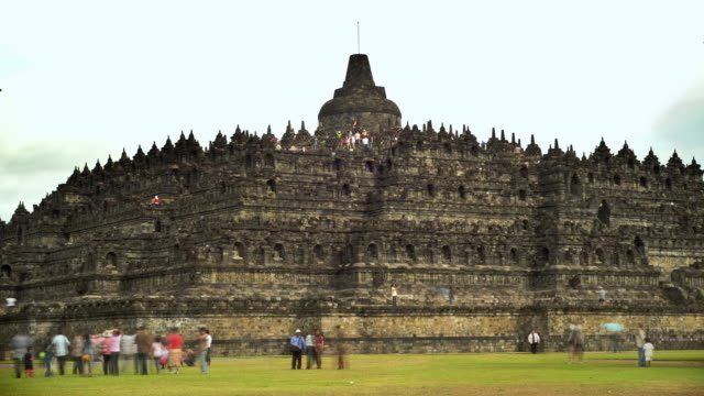 T/L WS Tourists walking around near Borobodur Temple/ Yogyakarta, Indonesia