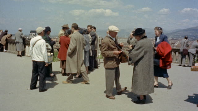 ms tourists walking around on piazzale michelangiolo / florence, italy - anno 1954 video stock e b–roll