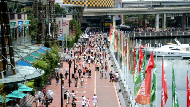 T/L tourists walking in Darling Harbour Sydney, the huge waterfront leisure park on the city centre's western edge