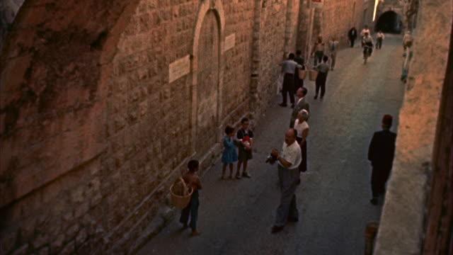 ms tourists walking in pilate courtyard - 飾り板点の映像素材/bロール