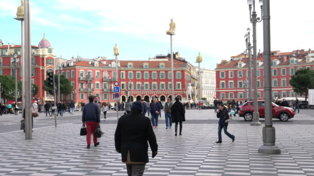 tourists walking in the place massena - square stock videos and b-roll footage