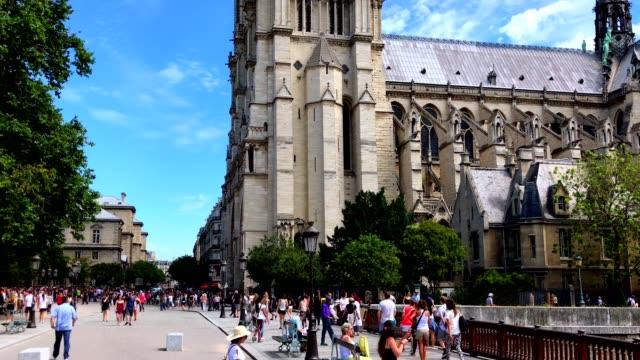 tourists walking near notredame de paris - notre dame de paris stock videos & royalty-free footage