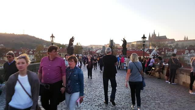 tourists walking on prague charles bridge - prague stock videos & royalty-free footage