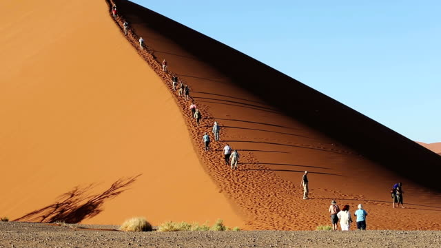 tourists walking on the famous dune 45 - sand dune stock videos & royalty-free footage