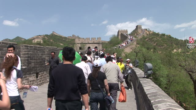 Tourists walking on the Great Wall of China in Beijing China