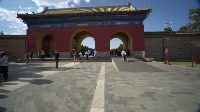 tourists walking through archway at traditional temple of heaven - beijing, china - temple of heaven stock videos & royalty-free footage