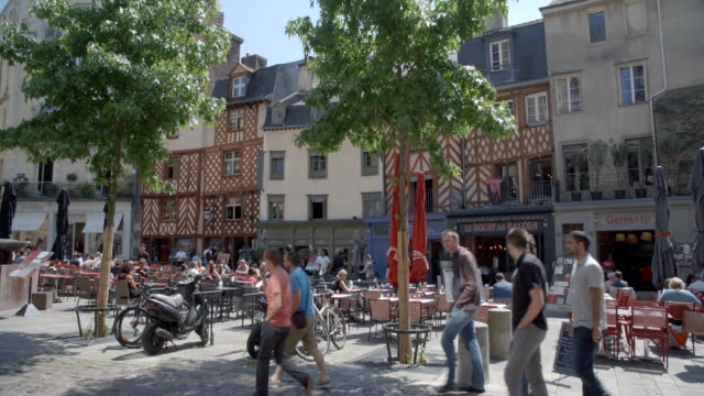 tourists walking through the town centre / rennes, france - rennes frankreich stock-videos und b-roll-filmmaterial