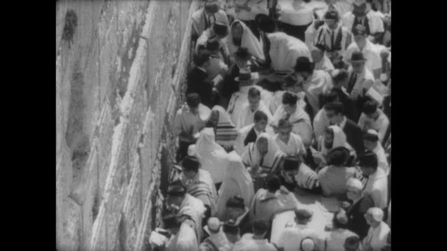 tourists walking towards the wailing wall in jerusalem / orthodox jewish men pray at the wall on rosh hashanah / women with covered heads at the... - wailing wall stock videos & royalty-free footage