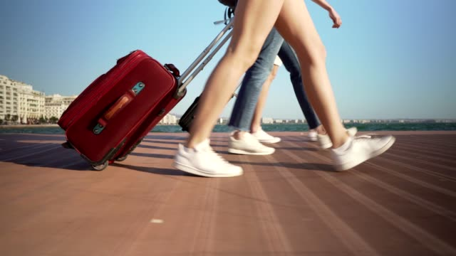 tourists walking with suitcases - suitcase stock videos & royalty-free footage