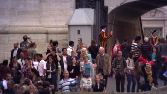 vatican city - may 2012 tourists watched by the swiss guard on may 8, 2012, in rome, italy. - swiss guard stock videos and b-roll footage