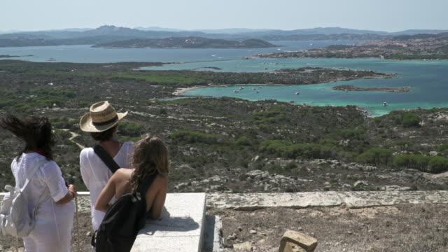 Tourists watching a mediterranean bay.