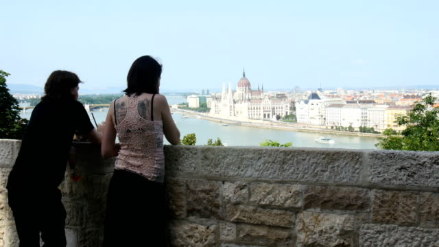 Tourists watching Budapest near Fountain of the Fishing Children, Buda Castle