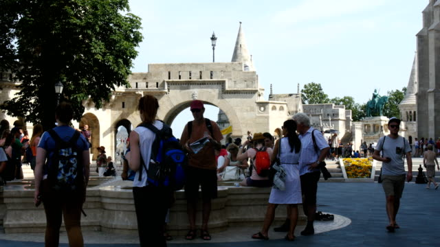tourists watching budapest near fountain of the fishing children, statue of prince eugene of savoy, and buda castle - royal palace of buda stock videos & royalty-free footage