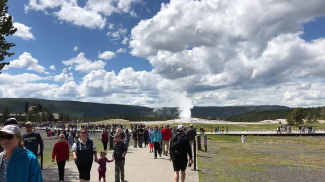 tourists watching old faithful geyser eruption - old faithful stock videos & royalty-free footage