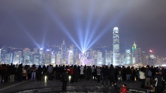 T/L WS Tourists watching skyscraper light show / Hong Kong, China