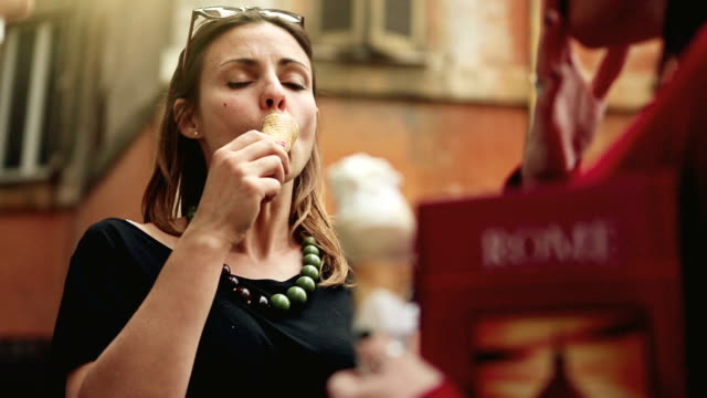 tourists with a guide eating icecream in rome - gelato stock videos and b-roll footage