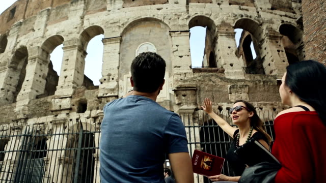 tourists with a guide in front of the coliseum, rome - tourist stock videos & royalty-free footage
