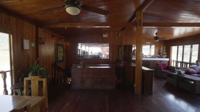tourists with wooden furniture at restaurant in cruise ship - luang phabang, laos - cruise stock videos & royalty-free footage