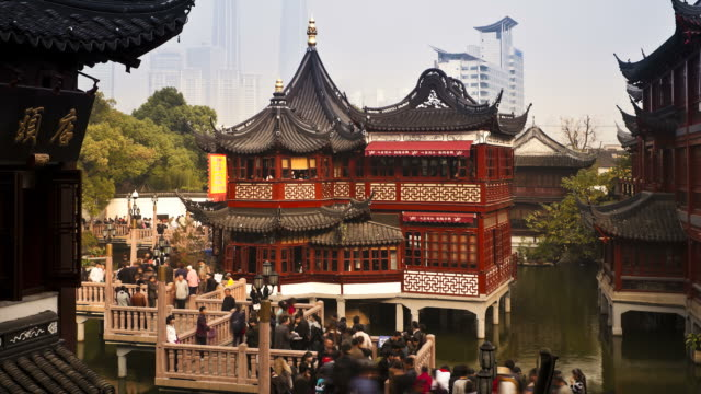 Tourists zig-zag along a bridge at the Mid-Lake Pavilion Teahouse in Shanghai.