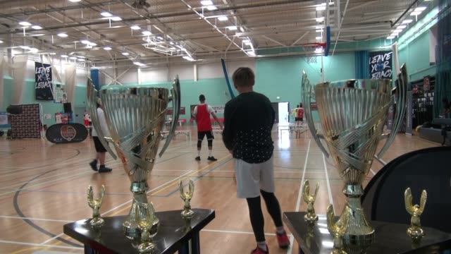 tournament raises money for cancer charity and to tackle knife crime; england: london: royal docks: int basketball players warming up before taking... - basketball player stock videos & royalty-free footage