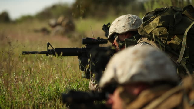 cu r/f tow soldiers on ground with gun audio / camp pendleton, ca, united states - army soldier stock videos & royalty-free footage