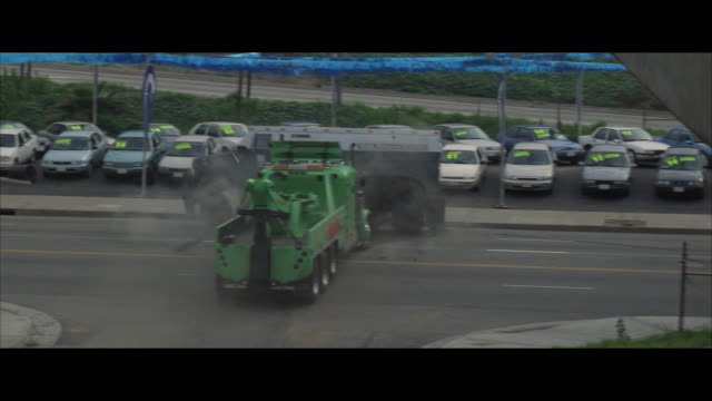 ha tow truck crushing into side of armored truck, men with gun running - armored truck stock videos and b-roll footage