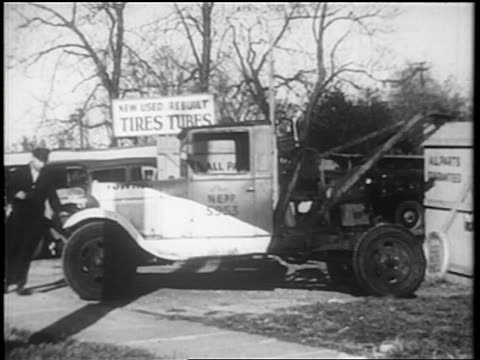 b/w 1939 tow truck driver hurrying to enter truck / documentary - tow truck driver stock videos and b-roll footage