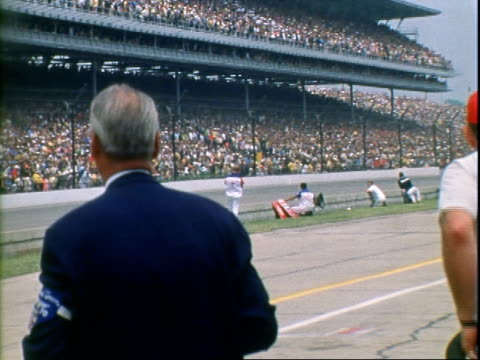 tow truck hauling away gerhardt offenhauser following accident at indianapolis motor speedway / indy race cars speeding past packed spectators stands... - tow truck driver stock videos and b-roll footage