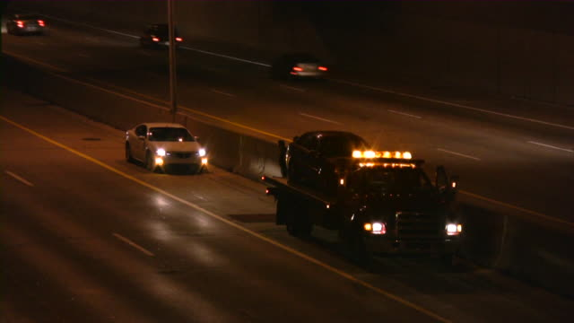 tow truck on highway. road assistance. emergency stop. - tow truck stock videos and b-roll footage