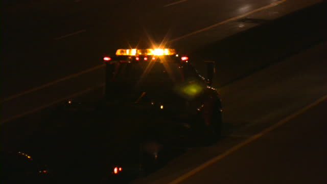 tow truck on highway. - tow truck stock videos and b-roll footage